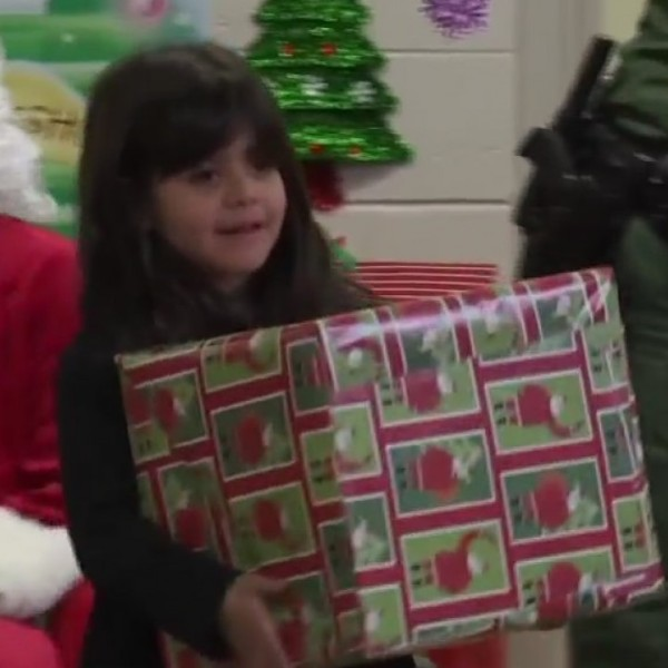 Border Patrol agents deliver gifts to children in Chihuahuita