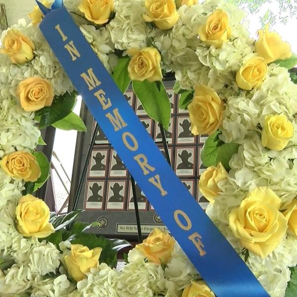 dps memorial wreath_1558484462135.jpg.jpg