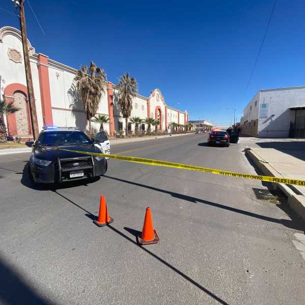 Crime scene on Texas Avenue with yellow police tape blocking off area and EPPD police car in the forground -- El Diario building on Texas Avenue is in the backgroun.