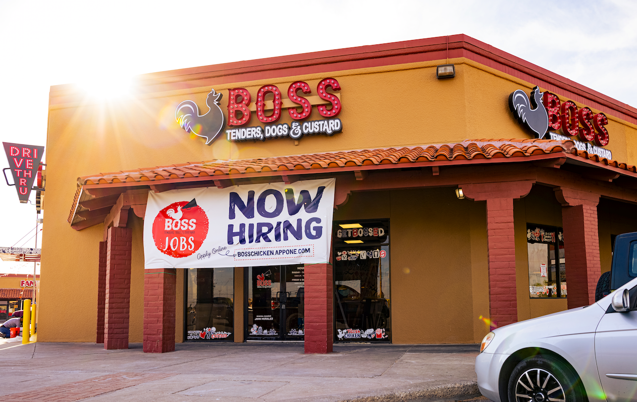 Boss Chicken restaurant opening a new location in a red and tan building.